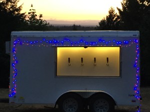 Red and blue lights provide a patriotic theme.  Two light strands can easily be attached using the external GFCI outlets on the keg trailer.